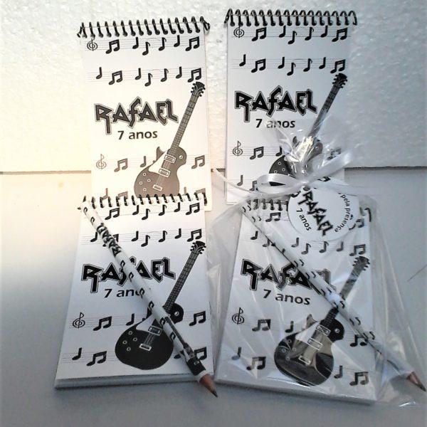 bloco de notas com lápis rock